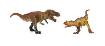 Tyrannosarie och carnotaurus på vit bakgrund Royaltyfri Foto