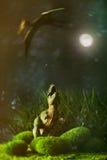 Tyrannosaure combattant avec un oiseau de vol préhistorique Photo stock