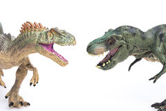 Tyrannosaurus and allosaurus toy on white Stock Photos