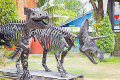 Tyrannosaurus Dinosaur made of remnant of iron in public park Stock Photography