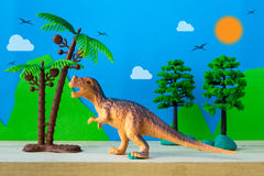 Tyrannosaurus dinosaur toy model on wild models background Royalty Free Stock Photography
