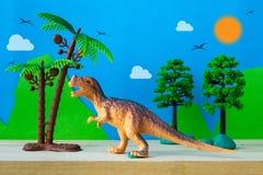 Tyrannosaurus dinosaur toy model on wild models background. Closeup Royalty Free Stock Photography