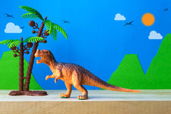 Tyrannosaurus dinosaur toy model on wild models background. Closeup Royalty Free Stock Image