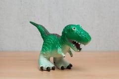 Tyrannosaurus dinosaurs toy on wooden table. Stock Photo