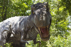 Tyrannosaurus. Hunting in the forest Royalty Free Stock Photography