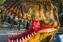Tyrannosaurus Rex. Attacking Tyrannosaurus Rex in forest.automated figure in park Stock Photography