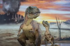 Tyrannosaurus rex with baby t-rex with cretaceous land in the background