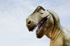 Tyrannosaurus rex dinosaur. And sky background Stock Photo