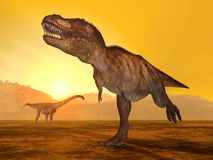 Tyrannosaurus Rex and Puertasaurus Royalty Free Stock Images
