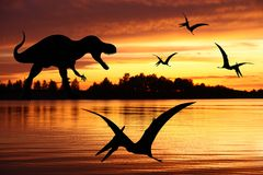 Tyrannosaurus rex and two pterodactyl. Tyrannosaurus rex and two flying pterodactyl or pteranodon stock photos