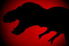 Tyrannosaurus shadow with red spot light Stock Images