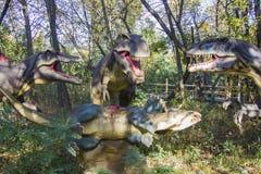 Tyrannosaurus, spinosaurus, allosaurus  and victim triceratops Stock Image