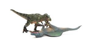 Tyrannosaurus spinosaurus i stojaki kłaść puszek na bielu Zdjęcie Stock