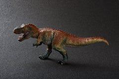 Tyrannosaurus toy on dark. Tyrannosaurus toy on a dark background Stock Photography