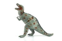 Tyrannosaurusstuk speelgoed op wit wordt geïsoleerd dat Stock Foto