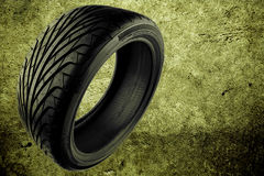 Tyre. Rubber auto tyre on abstract background Stock Image