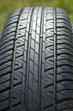 Tyre. Close up of pattern on rubber vehicle tyre Stock Photos