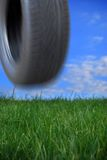 Tyre bouncing down hill Royalty Free Stock Photos