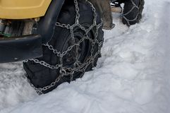 Tyre with chains. Tire with snow chains stock photos