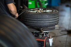 Tyre change - wheel balancing or repair and change car tire stock photography