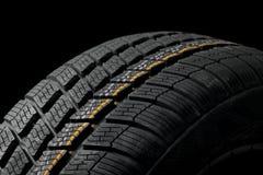 Tyre deatil. Winter tyre closeup, dark backgroud Royalty Free Stock Photos