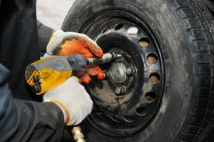 Tyre fitting with air compressed wrench Stock Photos