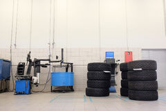 Tyre fitting machine and the sets of wheels Stock Image
