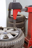 Tyre folding. Folding tyre to remove it from alu wheel Royalty Free Stock Photo