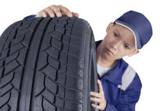 Tyre and male mechanic Royalty Free Stock Image