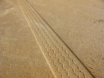 Tyre Marks on Beach Sand Stock Image