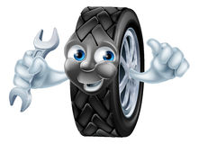 Tyre mascot character with spanner Royalty Free Stock Photos