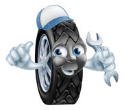 Tyre mechanic cartoon mascot Stock Images