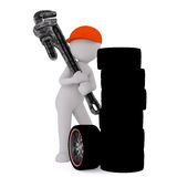 Tyre mechanic with wrench Royalty Free Stock Photos
