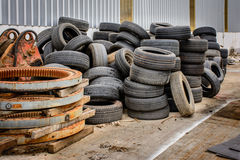 Old tyre, pile up at the back of building stock photo
