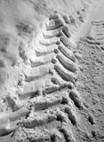 Tyre print in snow Stock Images