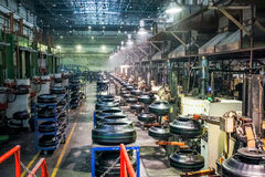 Tyre production machine conveyor at factory Royalty Free Stock Photography