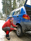 Tyre puncture. Man changing the wheel after a tyre puncture Stock Photography