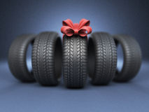 Tyre with a red ribbon. Gift. 3D Icon on blue Stock Photos