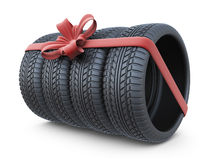Tyre with a red ribbon. Gift. 3D Icon  on white Royalty Free Stock Image