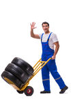 The tyre repairman with trolley isolated on white Royalty Free Stock Photo