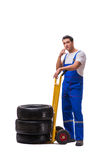 The tyre repairman with trolley isolated on white Stock Photos