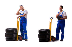 The tyre repairman with trolley isolated on white Stock Photo