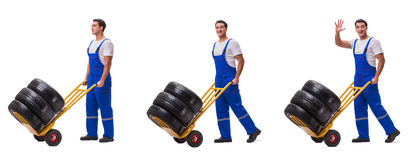 The tyre repairman with trolley isolated on white Royalty Free Stock Photos