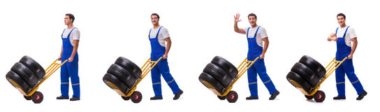 The tyre repairman with trolley isolated on white Royalty Free Stock Photography