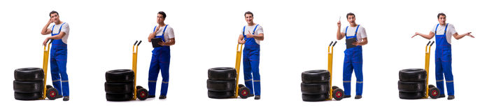 The tyre repairman with trolley isolated on white Stock Image