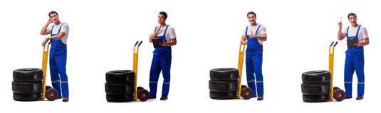 The tyre repairman with trolley isolated on white Royalty Free Stock Image