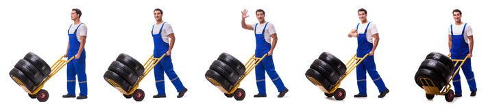 The tyre repairman with trolley isolated on white Stock Photography
