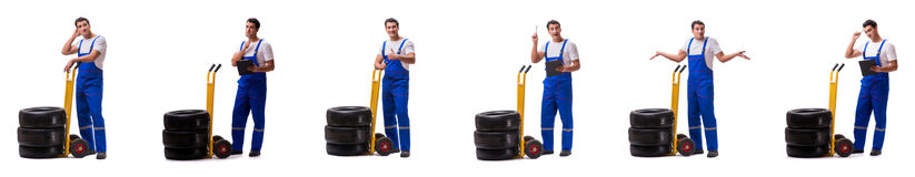 The tyre repairman with trolley isolated on white Royalty Free Stock Images