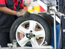 Tyre Service by Mechanic Royalty Free Stock Image