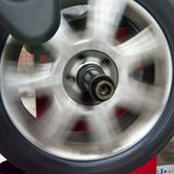 Tyre spinning on the balancing machine royalty free stock photos